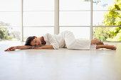 Serene woman napping  on floor