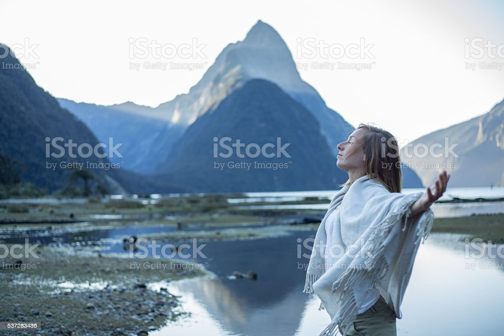 Serene woman relaxes in nature stock photo