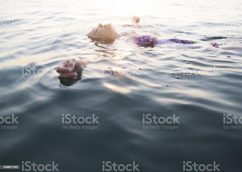 Serene Woman Swimming, Aegean sea, Akbuk, Turkey stock photo
