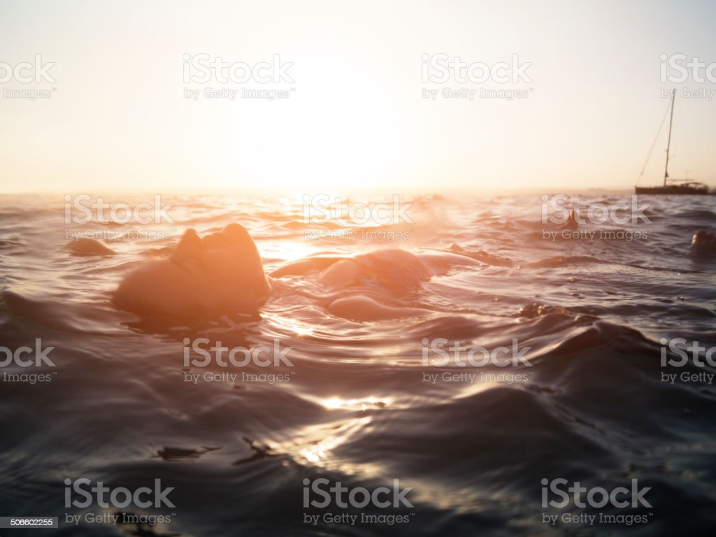 Serene Woman Swimming, Aegean sea, Akbuk, Turkey stock photo
