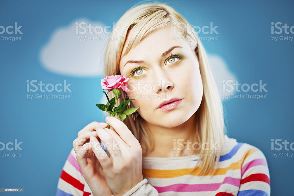 Serene woman with rose stock photo