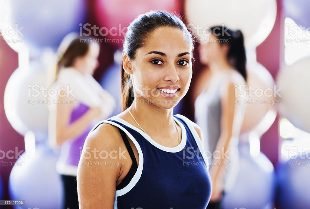 Serenely beautiful young woman relaxing after gym class stock photo