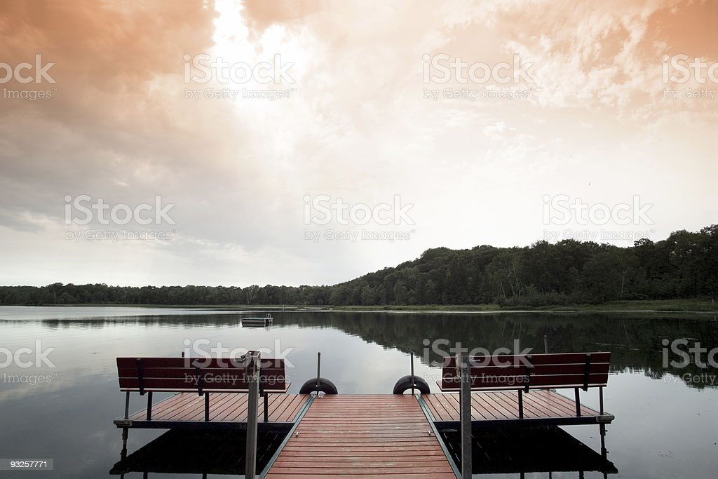 Serenity by the lake during twilight royalty-free stock photo