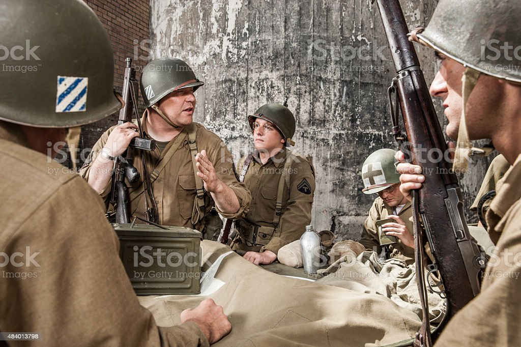 WWII Sergeant Explains Plan to Infantry Squad stock photo