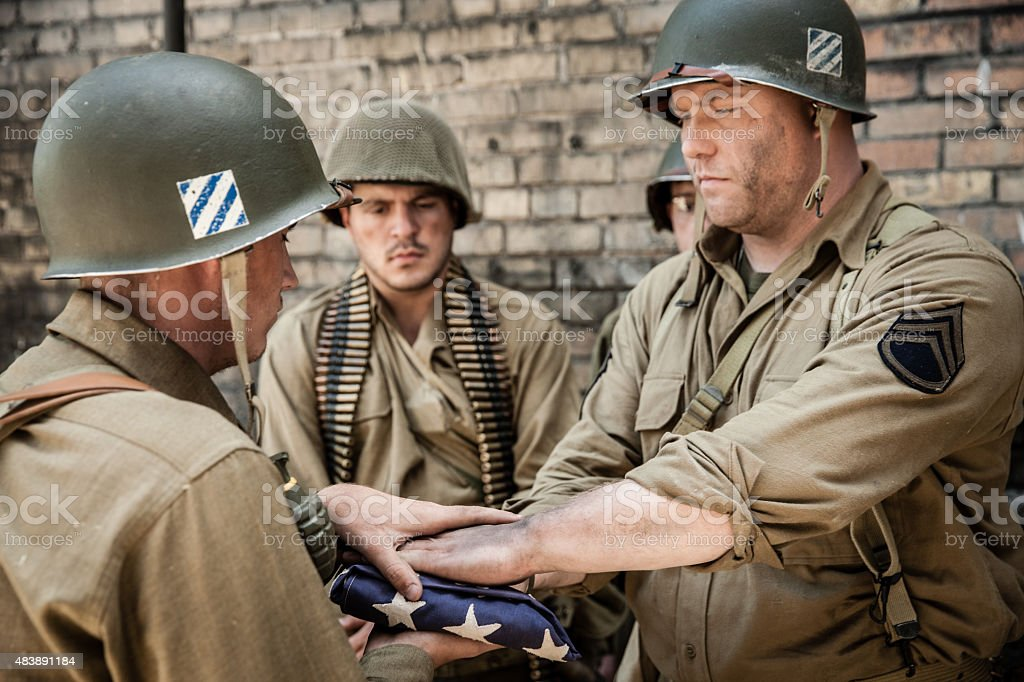 WWII Sergeant Hands Flag to Soldier Ceremony stock photo