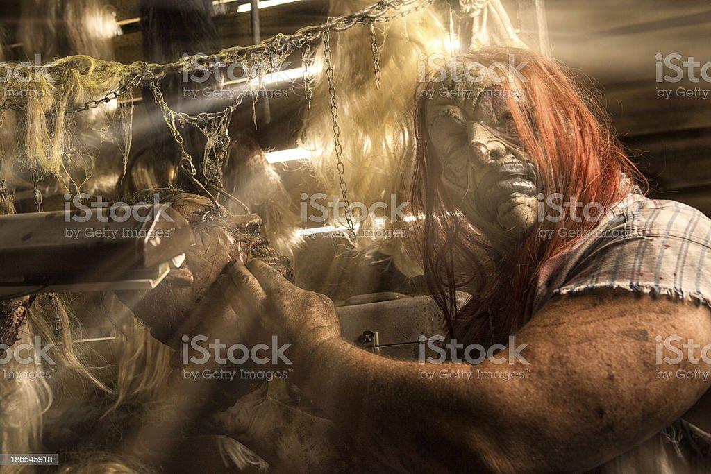 Serial Killer Clown hold victim in his cabin stock photo