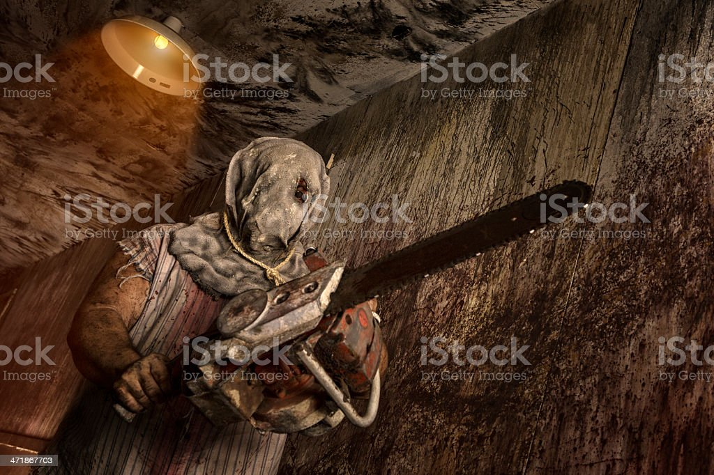Serial Killer holding chain saw stock photo