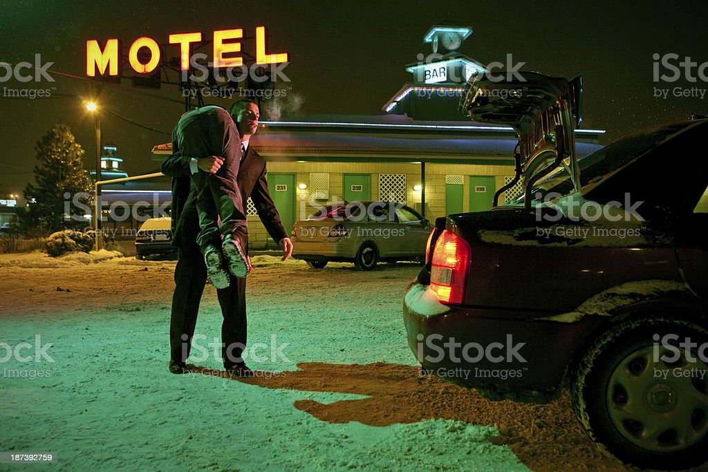 Serial Killer with a corpse on his shoulder stock photo