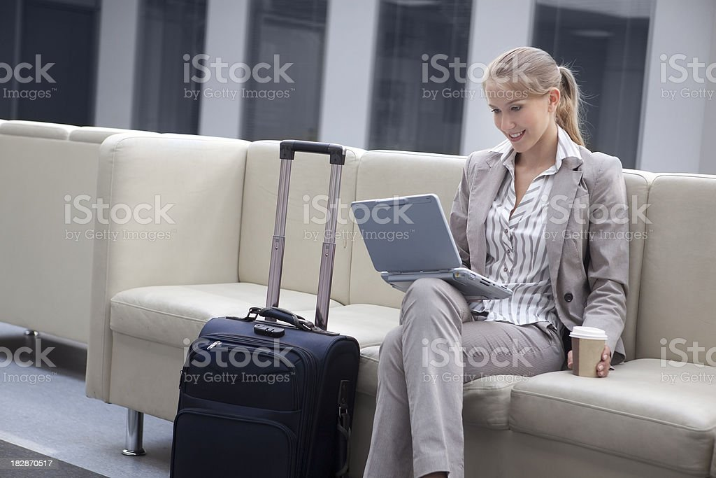 Series: Businesswoman Working on her Notebook  in the Airport . royalty-free stock photo