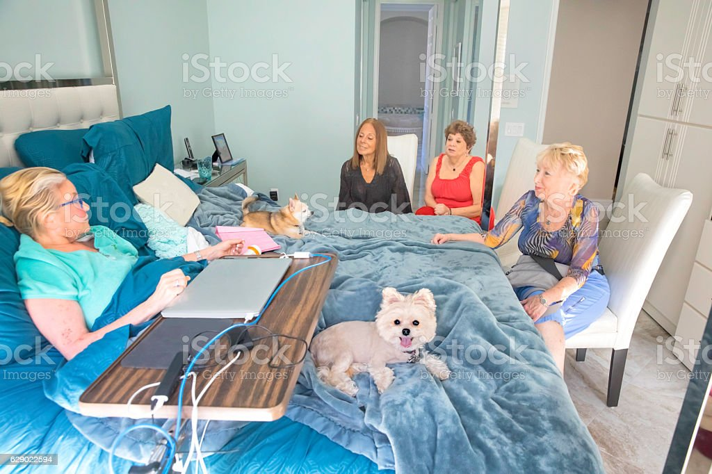 Series: Friends Visiting bedridden patient at home. stock photo