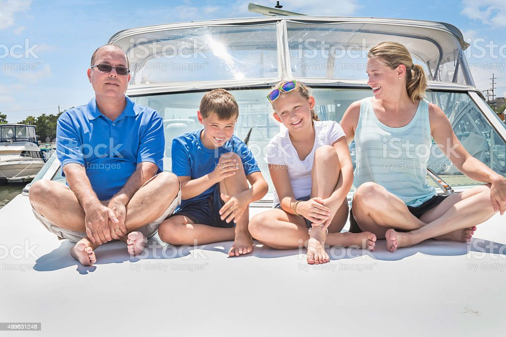 Series: Kidney recipient father enjoys life with family on boat stock photo
