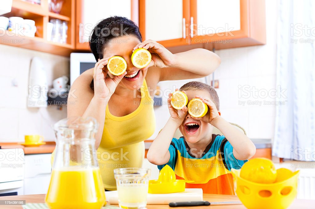 Series: Mother and child making lemonade royalty-free stock photo