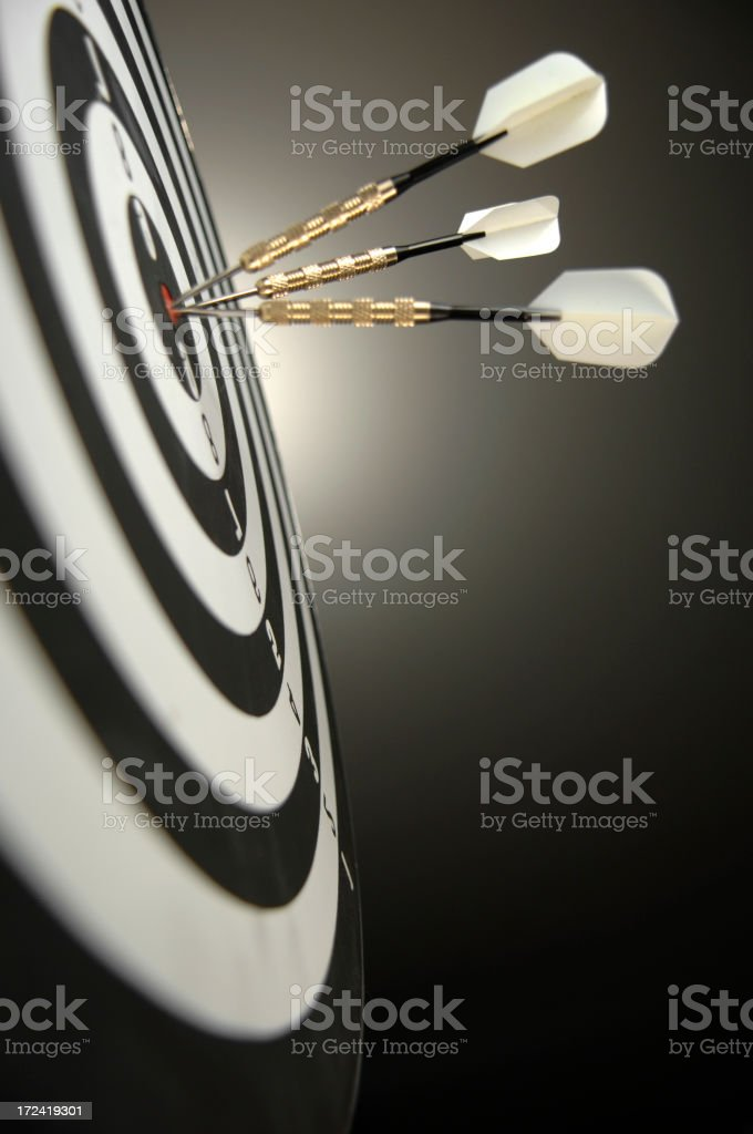 Series of 3 dots hitting the bullseye of a target. royalty-free stock photo