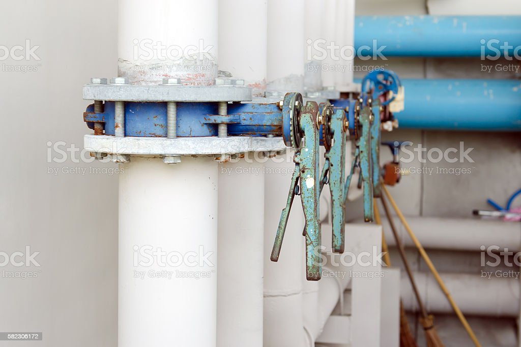 Series of butterfly valves on supply water piping stock photo