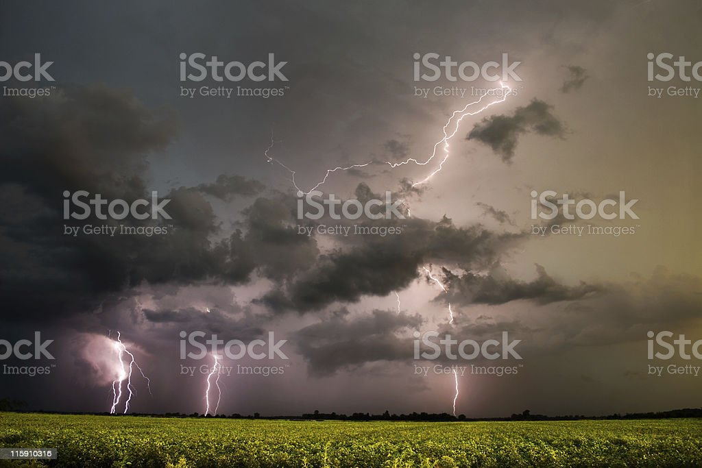 A series of lightning storms seen from the horizon stock photo