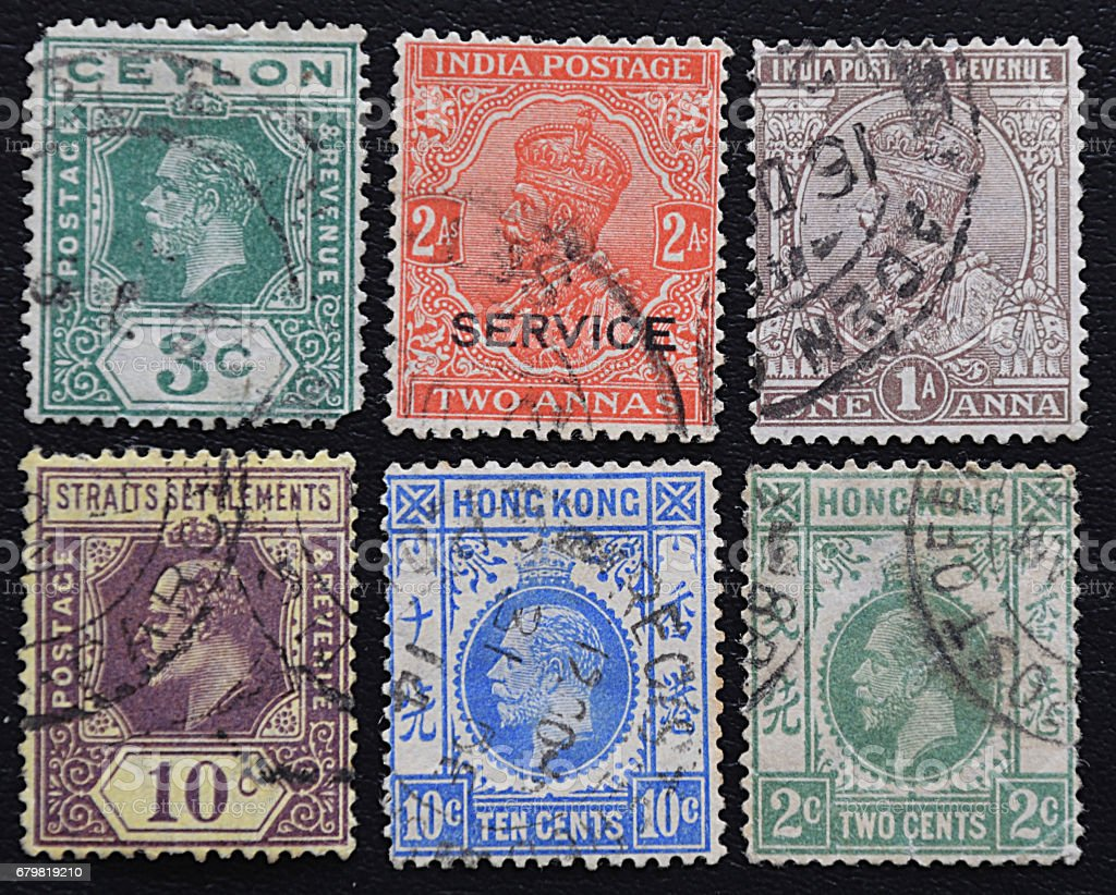 A series of old postage stamps of English colonies. stock photo