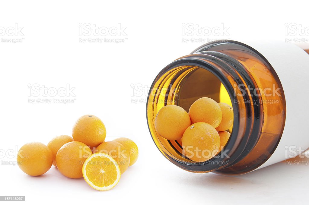 Series of oranges on medicine bottle representing vitamin c stock photo