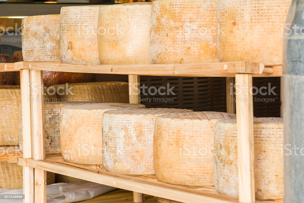 series of round forms of aged cheese for sale stock photo