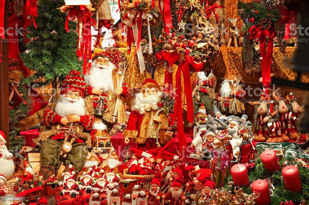 Series of Santa Claus dolls on Christmas Market royalty-free stock photo