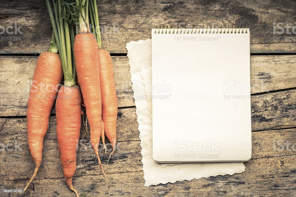 Series of Vegetables with recipe book on wooden table. stock photo