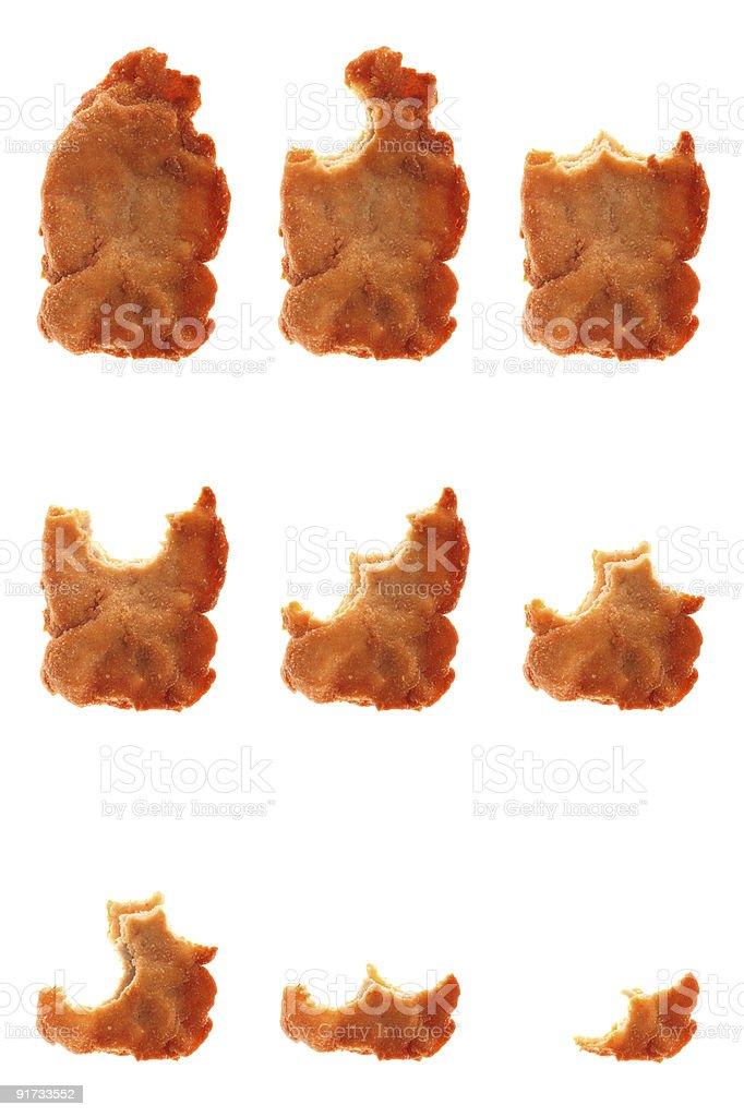 Series of whole and bitten wiener schnitzel being eaten away stock photo