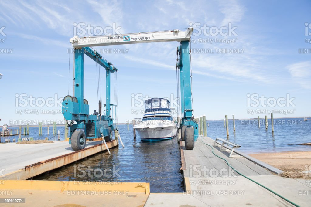Series: Yacht being put onto a marine travel lift stock photo
