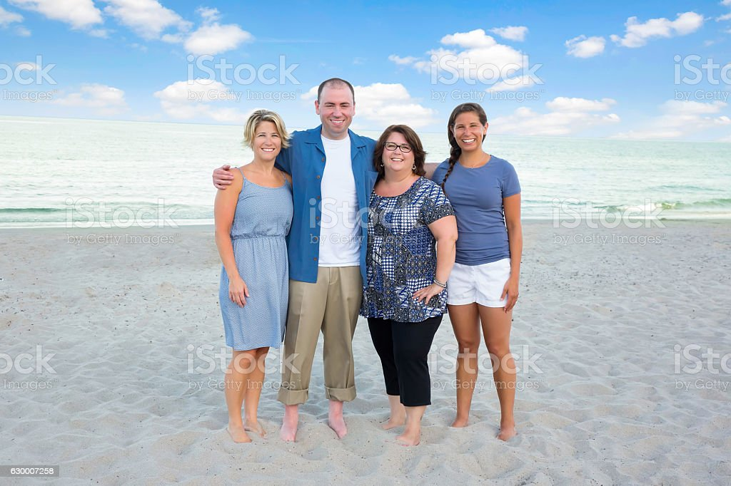 Series:Adults siblings dressed in blue at beach for family reunion stock photo