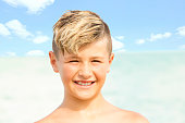 Series:Blond ten year old boy with big smile at beach