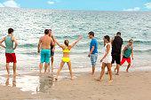 Series:Family having fun at the beach during reunion.