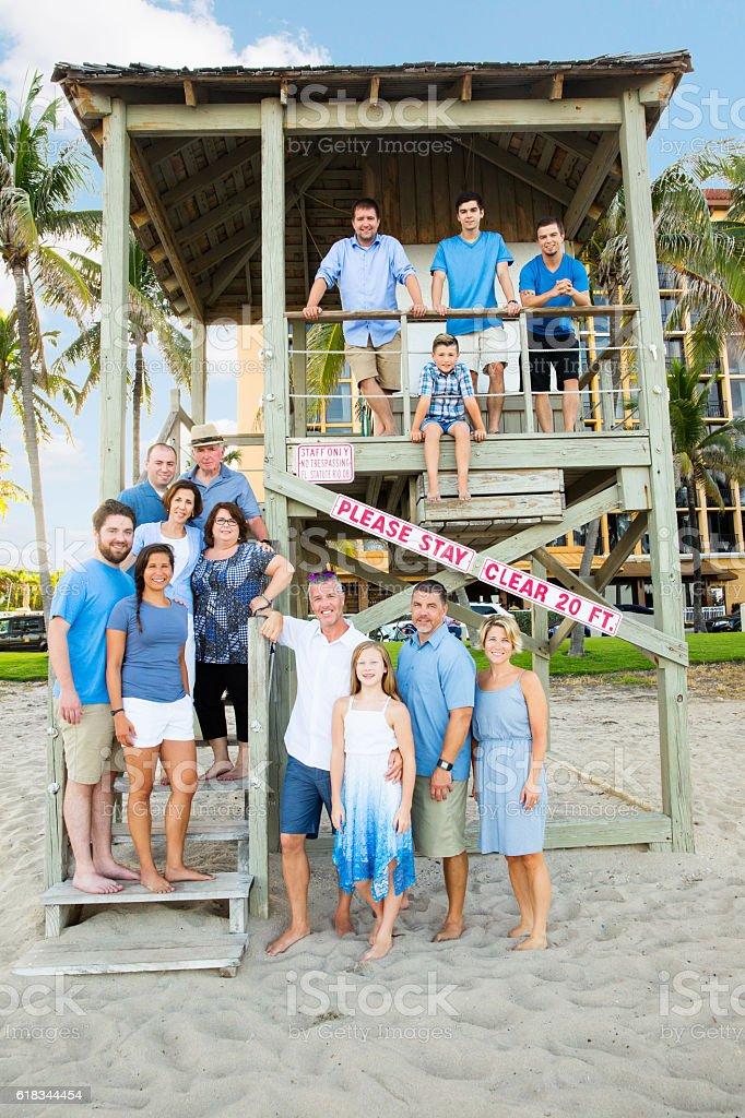 Series:Family having  reunion vacation at public beach stock photo