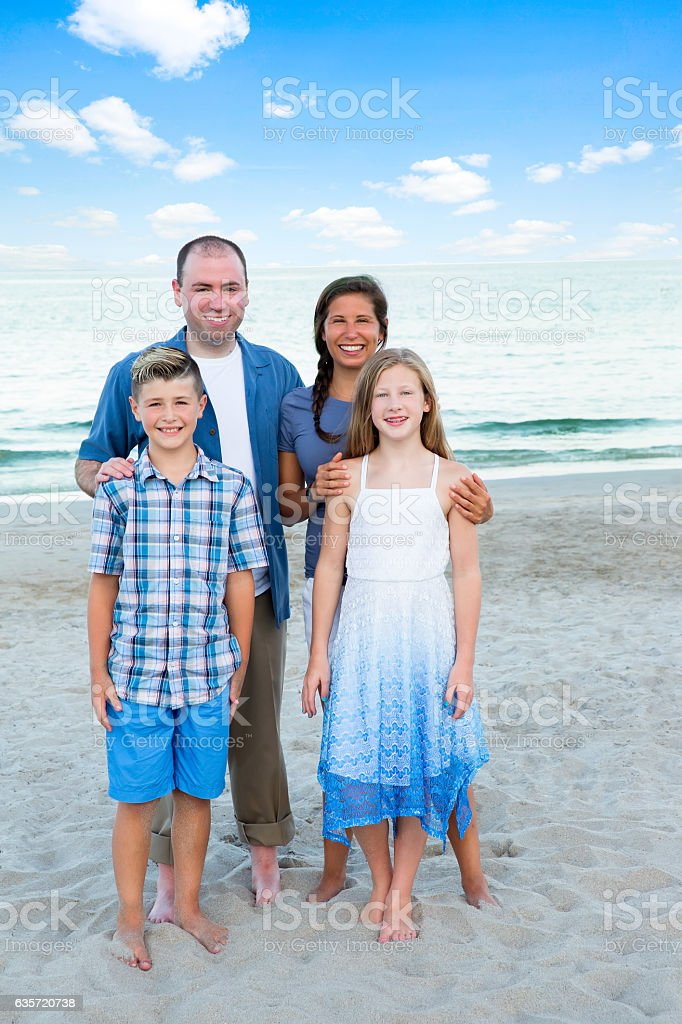 Series:Family members on beach for reunion vacation stock photo