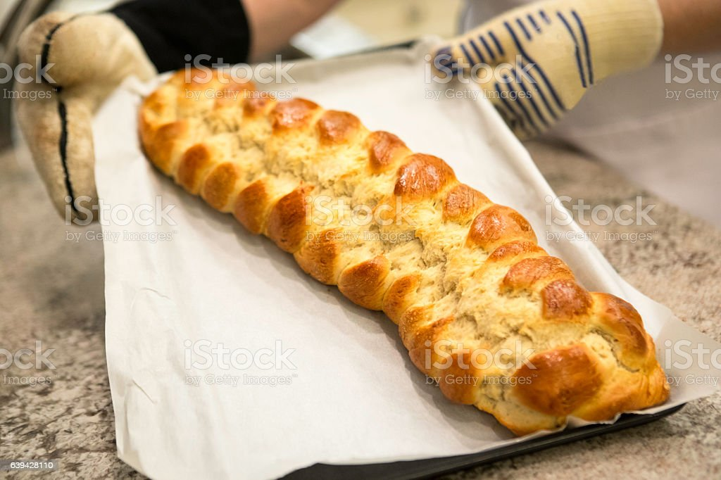 Series:Fresh baked braided challah on a baking sheet stock photo