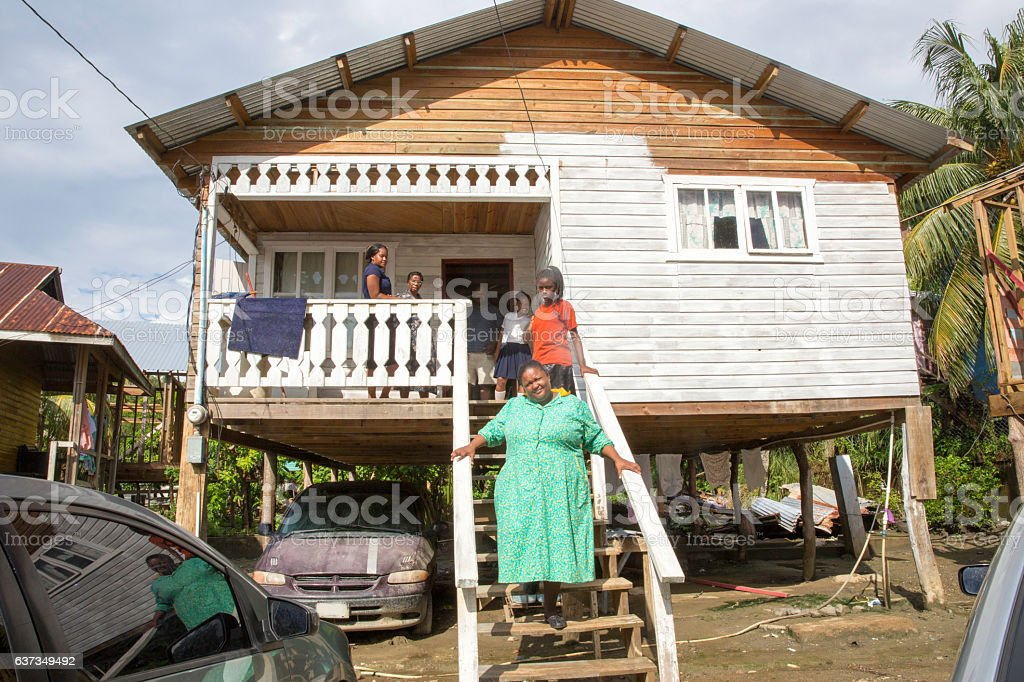 Series:Hounduran family on steps of shanty village home in Roatan stock photo
