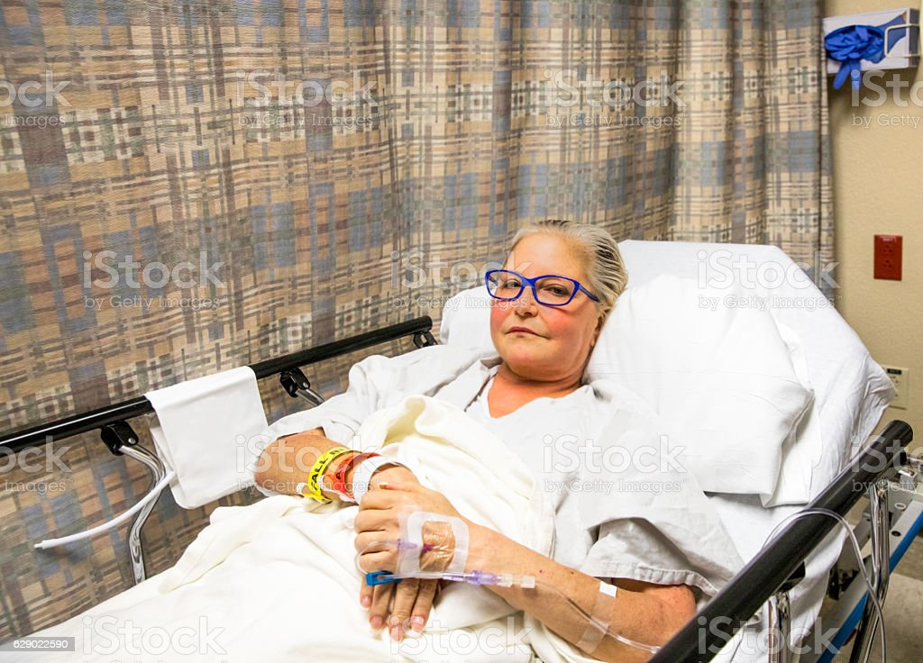 Series:Mid Age woman waiting to be wheeled into surgery stock photo
