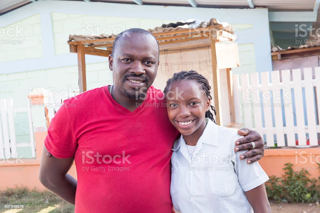 Series:Proud Honduran father with arm around teenage daughter stock photo