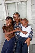 Series:Proud Honduran grandmother holding her two grandchildren