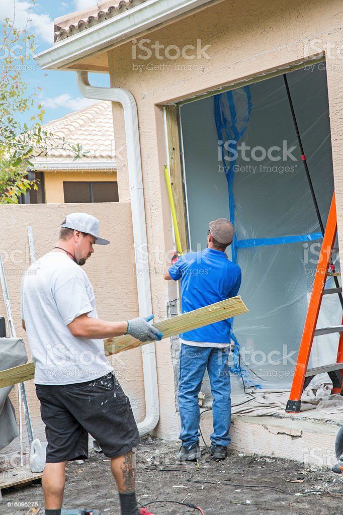 Series:Replacing sliding glass door with hurricane impact glass door stock photo