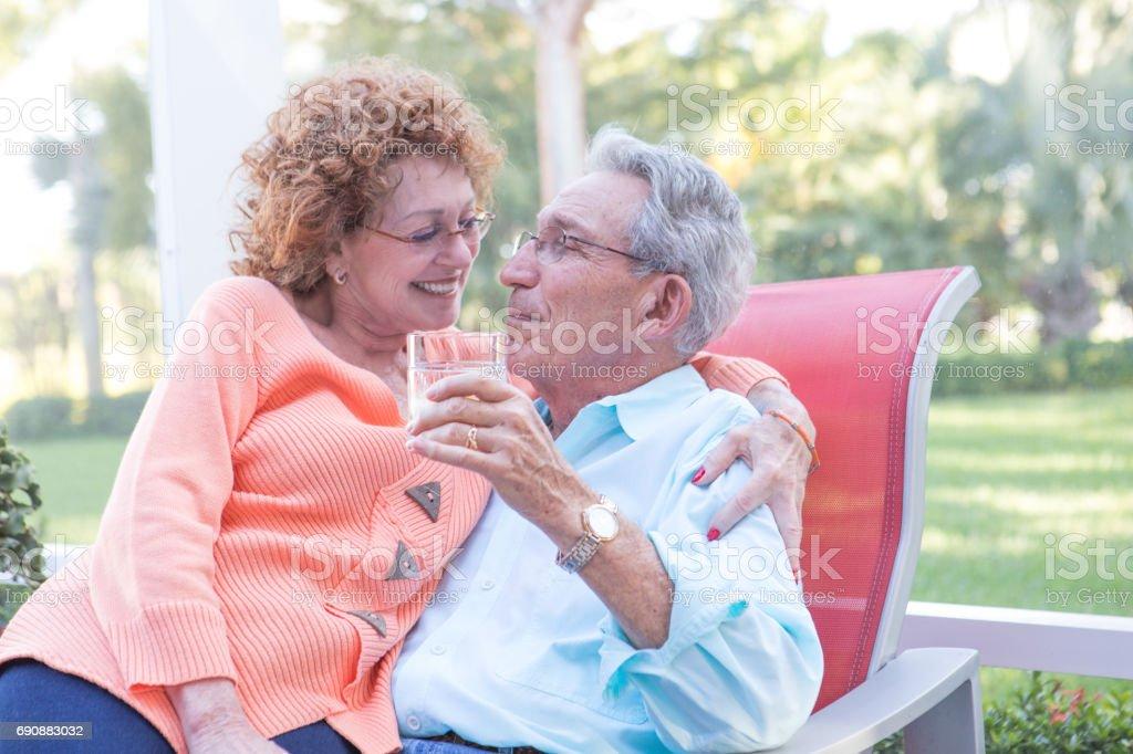 Series:Senior couple enjoying afternoon cocktail time outdoors stock photo