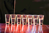 Series:Shots of tequila  are being poured on a bar