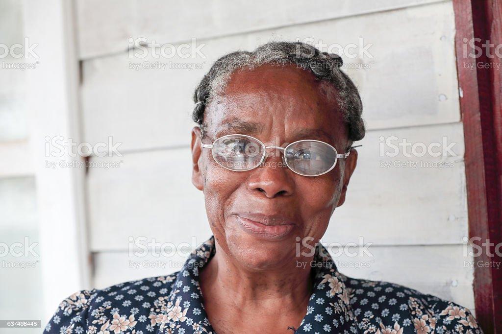 Series:Smiling Honduran senior woman wearing glasses stock photo