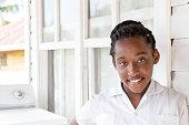 Series:Teenage Honduran girl wearing white school uniform shirt