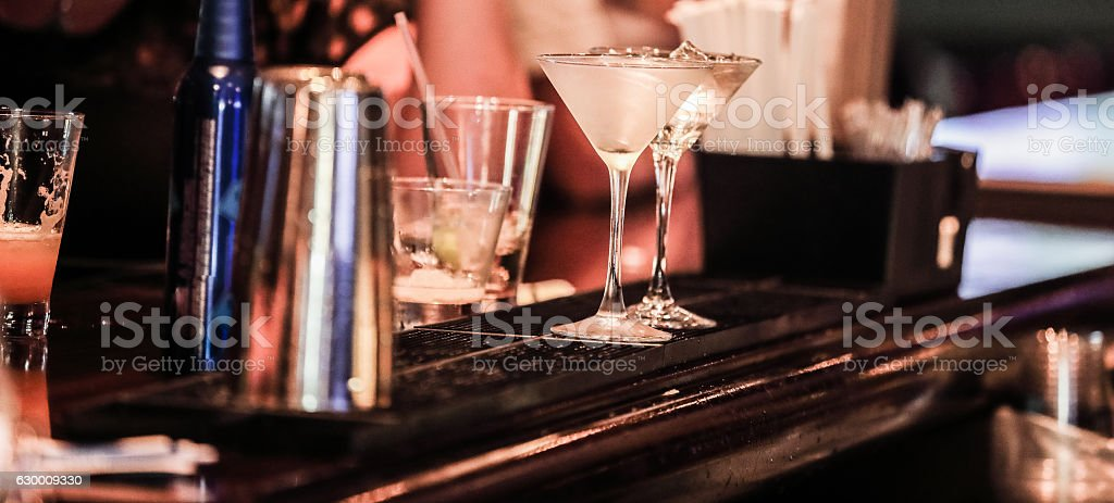 Series:View from behind a bar with unidentifiable people drinking stock photo