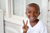 Series:Young Honduran boy making peace sign with fingers
