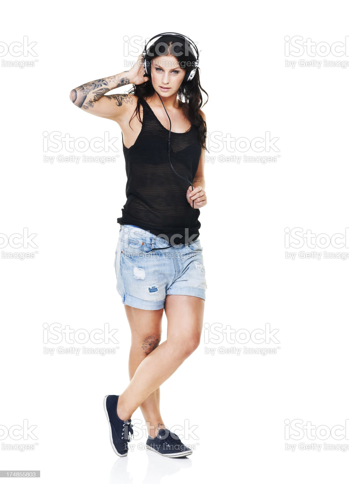 Serious about her music and tattoos! royalty-free stock photo
