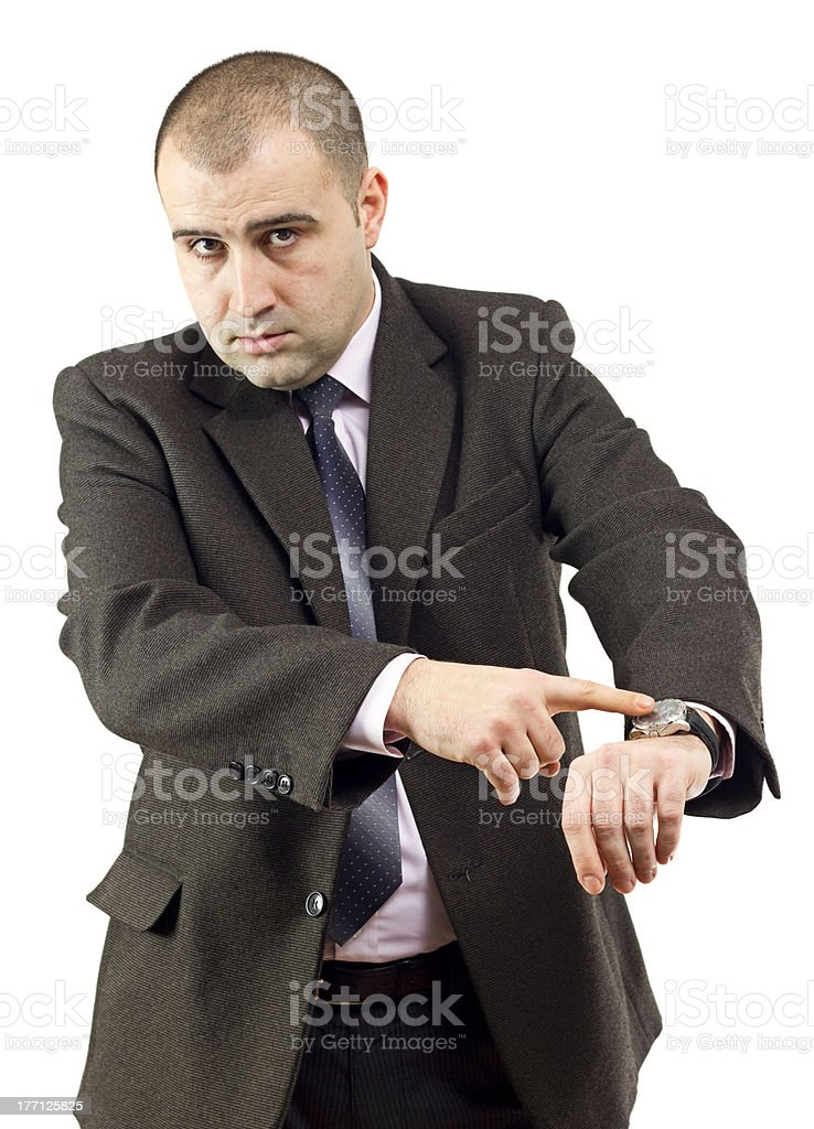 Serious adult businessman pointing to his watch stock photo