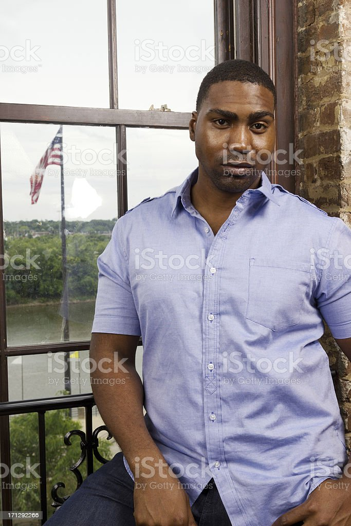 Serious African American Man Standing stock photo