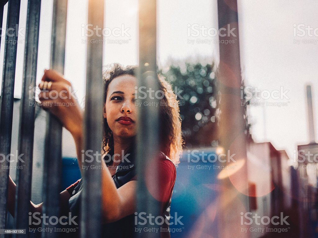 Serious African American teenage girl in an urban environment stock photo