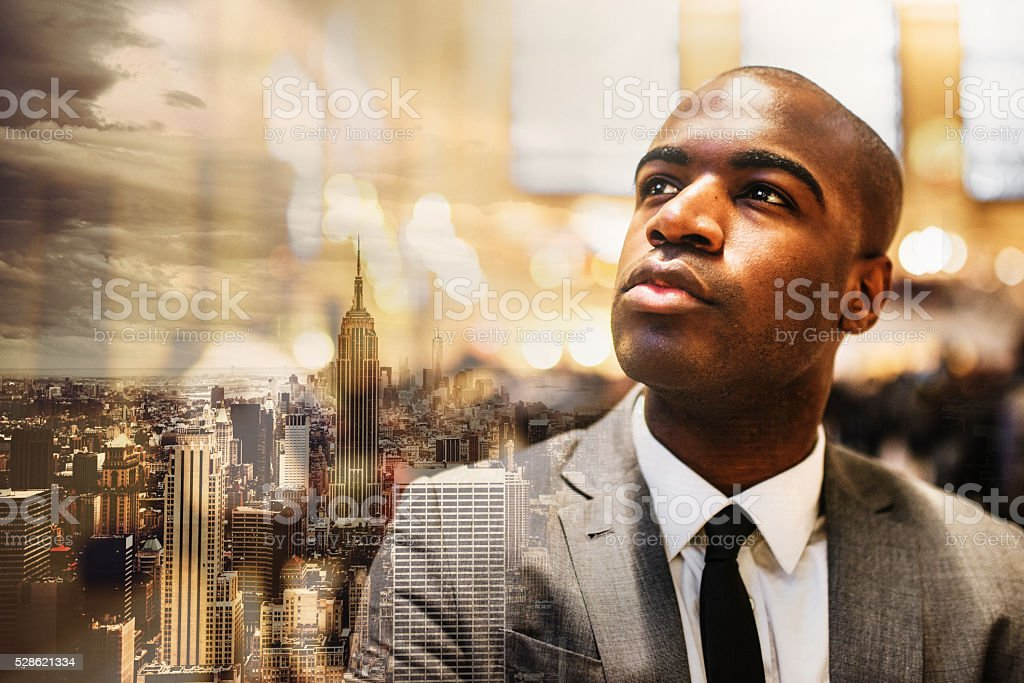 serious afroamerican businessman in manhattan stock photo