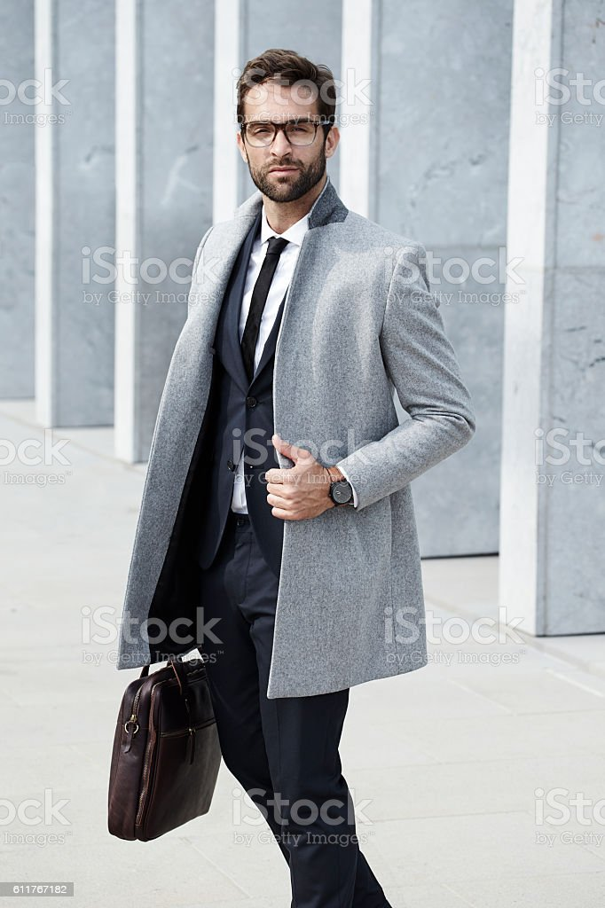 Serious and suited businessman stock photo