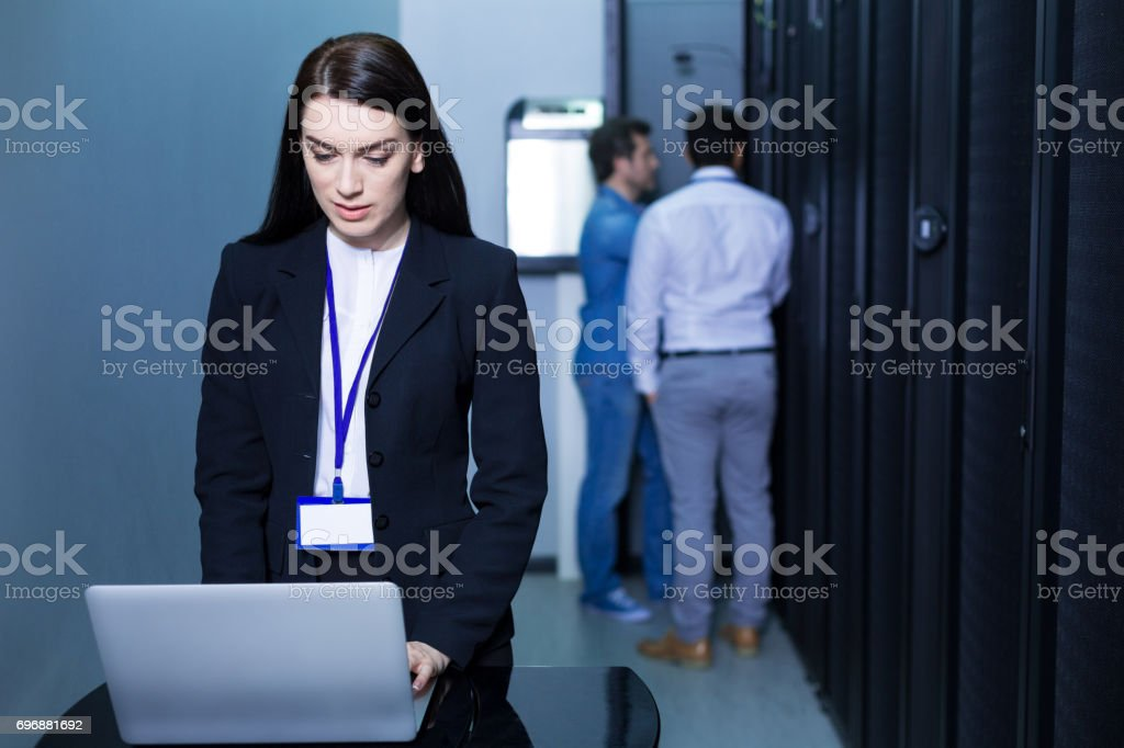 Serious attractive woman working on the laptop stock photo